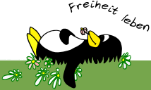 Penguin lying on meadow